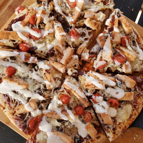 bbq chicken pizza with bacon on traeger smoker