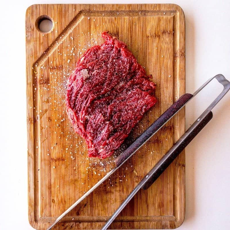 steak on cutting board brine